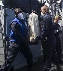 Apr 28, 2017 - Caribbean Sea - The Cyclone-class patrol coastal ship USS Zephyr (PC 8), its embarked U.S. Coast Guard Law Enforcement Detachment (LEDET) personnel and coalition forces intercepted an immense amount of contraband while on patrol conducting Operation Martillo in the U.S. 4th Fleet area of operations April 19th. Zephyr, along with Dutch Karel Doorman-class multi-purpose frigate HNLMS Van Amstel, pursued and boarded a small fishing vessel, called a panga, and interdicted 750 kilograms of cocaine with a total street value of $22.5 million. (Credit Image: © US Navy via ZUMA Wire/ZUMAPRESS.com)