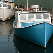 Pair of lobster boats in Gloucester, MA harbor on Cape Ann