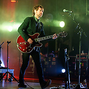 COLUMBIA, MD - June 6th,  2013 -   Aaron Dessner of The National performs on a rainy night at Merriweather Post Pavilion in Columbia, MD.  The band just released their sixth studio album, Trouble Will Find Me, which debuted at No. 3 on both the US and UK album charts. (Photo by Kyle Gustafson/For The Washington Post)