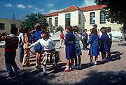 1970s schoolchildren play during break time at their school in rural Crete, on 13th Aril 1979, in Lasithi, Crete, Greece.