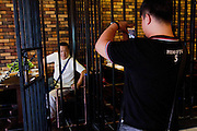 JILIN, CHINA - AUGUST 26: (CHINA OUT) <br /> <br /> Prison-themed Restaurant <br /> <br /> Customers have meals in a prison-themed restaurant on August 26, 2015 in Jilin, Jilin Province of China. The prison-themed restaurant provides a special experience as one could wear prison uniform and enjoy specialized prison set of meals here. <br /> ©Exclusivepix Media