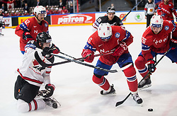 Sean Couturier of Canada vs Jonas Holos of Norway and Kristian Forsberg of Norway during the 2017 IIHF Men's World Championship group B Ice hockey match between National Teams of Canada and Norway, on May 15, 2017 in AccorHotels Arena in Paris, France. Photo by Vid Ponikvar / Sportida