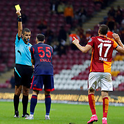 Referee Mete Kalkavan (L), Galatasaray's Burak Yilmaz (R) and Mersin idman Yurdu's Abdul Rahman Khalili (C) during their Turkish Super League soccer match Galatasaray between Mersin idman Yurdu at the AliSamiYen Spor Kompleksi TT Arena at Seyrantepe in Istanbul Turkey on Saturday, 12 September 2015. Photo by Kurtulus YILMAZ/TURKPIX