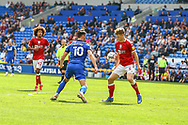 Bristol City's Rob Atkinson (5) under pressure from Cardiff City forward Kieffer More (10) during the EFL Sky Bet Championship match between Cardiff City and Bristol City at the Cardiff City Stadium, Cardiff, Wales on 28 August 2021.
