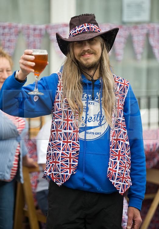 © Licensed to London News Pictures. 05/06/12.Saltburn, England...Residents of Eden Street in Saltburn by the Sea in Cleveland hold a street party as part of the Jubilee celebrations. Pictured is David Mee.. .The Royal Jubilee celebrations. Great Britain is celebrating the 60th  anniversary of the countries Monarch HRH Queen Elizabeth II accession to the throne this weekend Photo credit : Ian Forsyth/LNP
