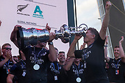 Shore crew man Sean Regan drinks from the America's Cup. Emirates Team New Zealand celebrate on stage after being presented with the Americas Cup on stage after beating Luna Rossa Prada Pirelli Team 7 - 3. Peter Burling fills the America's Cup with Champagne.  Wednesday the 17th of March 2021. Copyright photo: Chris Cameron
