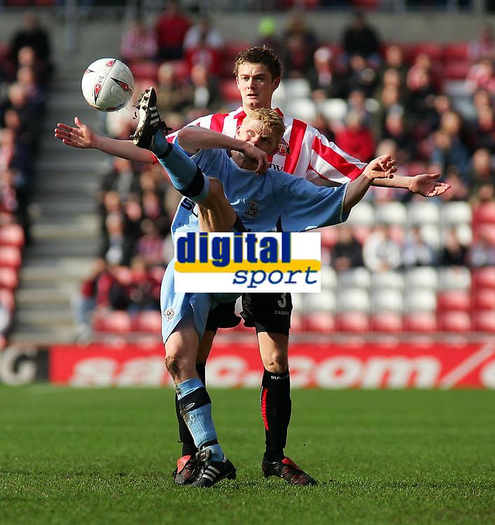 Photo. Andrew Unwin.<br /> Sunderland v Coventry, Coca-Cola Championship, Stadium of Light, Sunderland 19/03/2005.<br /> Coventry's Claus Jorgensen clears under pressure from Sunderland's George McCartney.