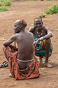 Daasanach tribe village the male elders sit around idle. Africa, Ethiopia, Omo Valley,