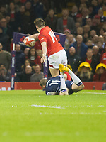 Rugby Union - 2018 Natwest Six Nations Championship - Wales vs. Scotland<br /> <br /> Josh Adams of Wales caught from behind by  Byron McGuigan, of Scotland , at The Millennium Stadium.<br /> <br /> COLORSPORT/WINSTON BYNORTH