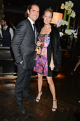 CAROLINE WINBERG and Wynton Faure at the OMEGA VIP dinner hosted by Cindy Crawford and OMEGA President Mr. Stephen Urquhart held at aqua shard', Level 31, The Shard, 31 St Thomas Street, London, SE1 9RY on 10th December 2014.