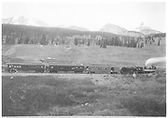 """RGS #12 with train returning from """"Silver Spike"""" celebration in Rico with Lizard Head Peak on skyline.  The coach-baggage is either #200 or #201; the coaches are of the #250-#253 series.<br /> RGS  Snow, CO  Taken by Carpenter, W. J. - 10/15/1891<br /> In book """"RGS Story, The Vol. IV: Over the Bridges? Ophir Loop to Rico"""" page 338<br /> Also at RD137-054.  Also in """"Silver San Juan"""", pp. 114-115; Galloping Geese on the RGS"""", p. 34; """"CRA #9"""", p. 34; """"Galloping Geese on the RGS"""", p. 34 and """"CRA #25"""", p. 317."""