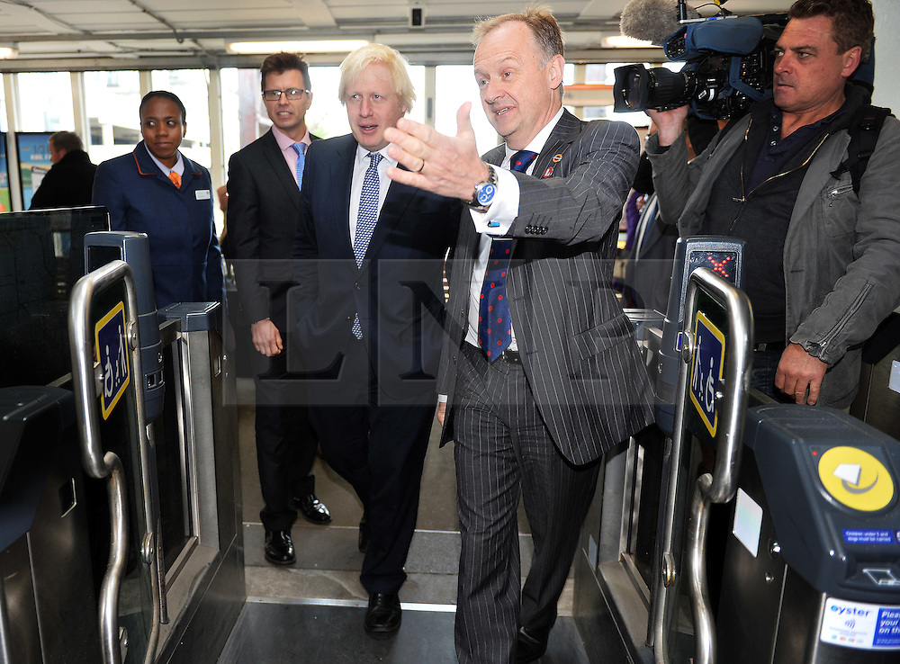 © Licensed to London News Pictures. 01/06/2015. <br /> LONDON, UK. Boris Johnson (C) welcomes expansion of TfL rail services. The Mayor of London visits Enfield Town station to meet staff ahead of TfL taking on responsibility of additional stations and a number of rail services out of Liverpool Street station, London, Monday 01 June 2015. Photo credit : Hannah McKay/LNP