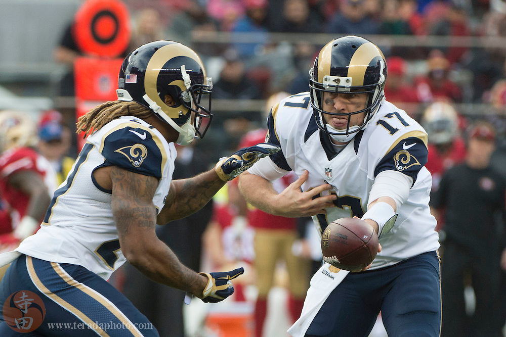 January 3, 2016; Santa Clara, CA, USA; St. Louis Rams quarterback Case Keenum (17) hands off to running back Tre Mason (27) against the San Francisco 49ers during the first quarter at Levi's Stadium.