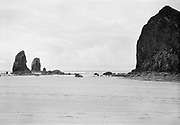 410600. old Ford car next to Haystack Rock, Cannon Beach, Oregon. June 1941