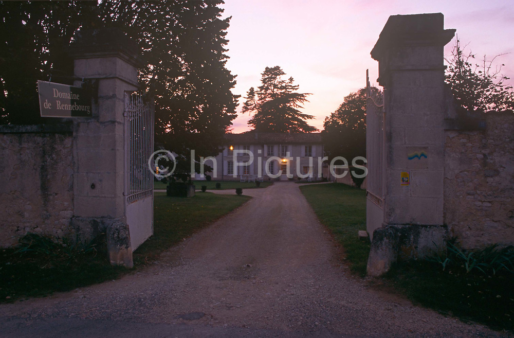 Evening exterior looking through the gates of Domaine de Rennebourg, a gite property in south-western rural France, on 15th October 1997, in Saint-Denis-du-Pin, Charente-Maritime, France.