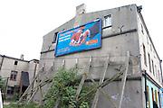 Ad for a new house on an old dilapidated building near the Balucki Rynek Market.  Lodz   Central Poland