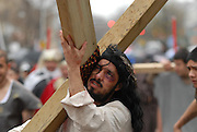 Actors Juan Ponce, 27 portrays Jesus Christ during a Good Friday Via Crucis at St. Jerome Catholic Church in Chicago's Rogers Park neighborhood. The religious portrayal recounts the biblical steps of Jesus Christ being condemned to death, followed by his crucifixion and entombment.