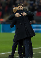 Football - 2018 / 2019 UEFA Champions League - Group B: Tottenham Hotspur vs. Inter Milan<br /> <br /> Mauricio Pochettino, Manager of Tottenham FC, consoles Luciano Spalletti, Manager of Inter Milan, at the final whistle at Wembley Stadium.<br /> <br /> COLORSPORT/DANIEL BEARHAM