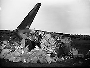 """Air Italia Crash at Shannon Airport.26/02/1960..An Alitalia Douglas DC-7C crashed after taking off from the airport, killing 34 people out of 52 passengers and crew on board...The Alitalia flight, on the Roma-Shannon-New York route, was being flown under the supervision of a check pilot. The aircraft took off from runway 05 and a left turn was initiated at 165 feet height. Height was lost during the turn, and the left wing tip contacted the ground. The left wing and no. 1 and 2 propellers then struck the stone wall and grave stones of the Clonloghan Church. The DC-7 then impacted the ground at a 170-180 knots airspeed...An official investigation following the crash concluded: """"No definite evidence leading to a particular reason for this accident was revealed by the investigation. It can only be concluded that the aeroplane lost height in a turn shortly after takeoff and struck the ground."""""""