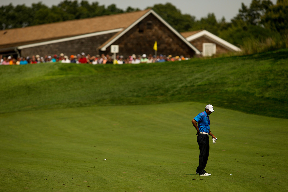 FARMINGDALE, NY - AUGUST 24:  Tiger Woods holds his lower back during the second round of the 2012 Barclays at the Black Course at Bethpage State Park in Farmingale, New York on August 24, 2012. (Photograph ©2012 Darren Carroll) *** Local Caption *** Tiger Woods