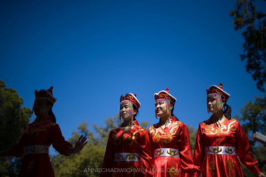 Women who have children attending the New Star Chinese School in Davis perform a Mongolian dance during the 95th annual UC Davis annual picnic day.