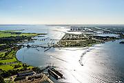 Nederland, Noord-Holland, Amsterdam, 27-09-2015; Zeeburg, zicht op Zeeburgeiland en met  IJburg in het veschiet. Oranjesluizen, Buiten-IJ, Ring A10 met Zeeburgertunnel, Buiten-IJ en Nieuwe Diep.<br /> View of East of Amsterdam, and the former Eastern Docklands and the IJ.<br /> luchtfoto (toeslag op standard tarieven);<br /> aerial photo (additional fee required);<br /> copyright foto/photo Siebe Swart