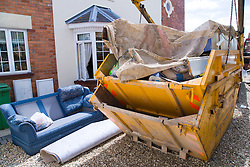 Skip of household furniture damaged after torrential rain caused the river Severn to bust its banks and flooded the Tewkesbury area; Gloucestershire; July 2007,