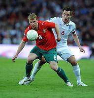 Sergei Kornilenko<br /> Belarus 2009/10<br /> John Terry England<br /> England V Belarus (3-0) 14/10/09 <br /> Fifa World Cup Qualifier<br /> Photo Robin Parker Fotosports International