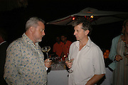 Tom Doig and Blake Morrison. Dinner at L'Archipel Restaurant hosted by Patrice Binet-Descamps. Prince Maurice. Mauritius. 25 May 2006. ONE TIME USE ONLY - DO NOT ARCHIVE  © Copyright Photograph by Dafydd Jones 66 Stockwell Park Rd. London SW9 0DA Tel 020 7733 0108 www.dafjones.com
