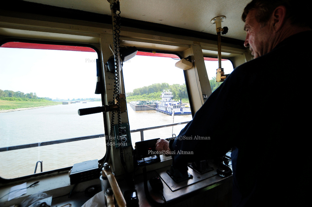 {8/24/12} {10pmCST} -JOB # 42286- Greenville , MS, U.S.A. -- Sandbars creep up as the water level drops on the Mississippi River makeing navigating the Mississippi River difficult for tug boat captains Ron Mook , Friday August 24,2012. Historically low river levels on the Mississippi River are causing havoc on river traffic: grounding barges loaded with grain and fertilizer, traffic jams several miles long and forcing the Coast Guard to close down chunks of the river due to groundings. The area around Greenville, Miss., has closed three times the past week due to groundings. Last year, there were five total groundings the entire low-water season. Locals who fought historic high-water floods last year are this year engaged in a different fight: keeping barges afloat on a vanishing Mississippi.  -- Photo by Suzi Altman, Freelance.