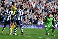 West Brom's Stephane Sessegnon © celebrates with Scott Sinclair (l) after he scores the 1st goal. Barclays Premier league match, West Bromwich Albion v Sunderland at the Hawthorns in West Bromwich, England on Sat 21st Sept 2013. pic by Andrew Orchard, Andrew Orchard sports photography,