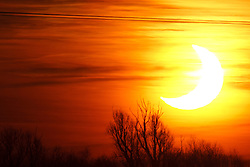©under licence to London News Pictures. 04/01/2011. Solar Eclipse over Huntingdon,  East Anglia. The Moon partially covered the rise of the Sun. Photo credit should read Jason Patel/London News Pictures