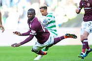 Clevid Dikamona (#28) of Heart of Midlothian blocks a shot from Scott Sinclair(#11) of Celtic FC during the Betfred League Cup semi-final match between Heart of Midlothian FC and Celtic FC at the BT Murrayfield Stadium, Edinburgh, Scotland on 28 October 2018.