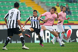 Alexis Sanchez of Udinese vs Armin Bacinovic of Palermo during football match between Udinese Calcio and Palermo in 8th Round of Italian Seria A league, on October 24, 2010 at Stadium Friuli, Udine, Italy.  Udinese defeated Palermo 2 - 1. (Photo By Vid Ponikvar / Sportida.com)