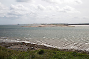 Narrow coastal channel between mainland and Holy Island, Lindisfarne, Northumberland, England, UK