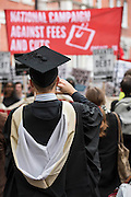 Some recent graduates come out of their degree ceremony in front of the march - A student march against fees and many other issues starts in Malet Street and heads for Westminster via the West End.