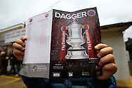 a Fan reading an FA Cup cover special programme . The Emirates FA Cup, 2nd round match, Dagenham & Redbridge v Whitehawk FC at the The London Borough of Barking & Dagenham Stadium in London on Sunday 6th December 2015.<br /> pic by John Patrick Fletcher, Andrew Orchard sports photography.
