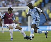 Photo: Aidan Ellis.<br /> Manchester City v West Ham United. The Barclays Premiership. 23/09/2006.<br /> City's Ishmael Miller takes on west Ham's Javier Mascherno
