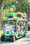 A golf cart float decorated in Irish themes during the annual Independence Day golf cart and bicycle parade July 4, 2019 in Sullivan's Island, South Carolina. The tiny affluent Sea Island beach community across from Charleston holds an outsized golf cart parade featuring more than 75 decorated carts.