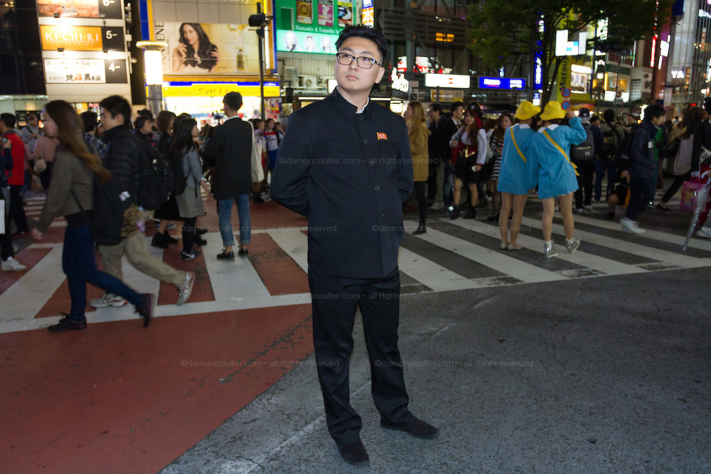 A man dressed at North Korean dictator, Kim Jong Un during the Halloween celebrations in Shibuya, Tokyo, Japan. Saturday October 29th 2016 Halloween celebration in Japan have grown massively in the last few years. To ensure the safety of the crowds in Shibuya this year, the police closed several roads leading to the famous Hachiko Square, allowing costumed revellers to spread over a larger area.