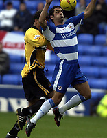 Picture: Henry Browne.<br />Date: 08/11/2003.<br />Reading v Wigan Athletic Nationwide Division One.<br /><br />Scott Murray of Reading holds off Lee McCulloch of Wigan