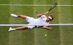 Alexander Zverev in action against Jiri Vesely on day one of the Wimbledon Championships at the All England Lawn Tennis and Croquet Club, Wimbledon.