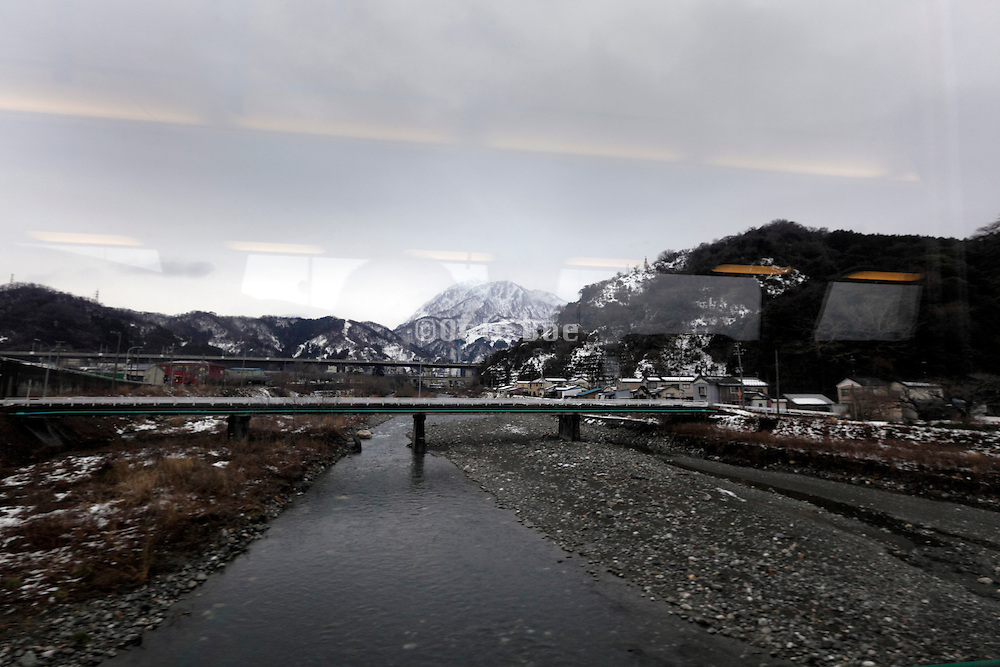 traveling by train through Toyama prefecture in Japan