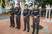 """24 JUNE 2014 - BANGKOK, THAILAND: Thai police officers line the sidewalk while members of the """"Monsoon Poets Society"""" gather in front of the Anantasamakom Throne Hall Tuesday to pay homage to the People's Party, a Siamese (Thai) group of military and civil officers (which became a political party) that staged a bloodless coup against King Prajadhipok (Rama VII) and changed Thailand (then Siam) from an absolute monarchy to a constitutional monarchy on 24 June 1932. Since the coup against the civilian government on 22 May, the ruling junta has not allowed political gatherings. Although police read the poems, they did not arrest any of the poets or make any effort to break up the gathering.     PHOTO BY JACK KURTZ"""
