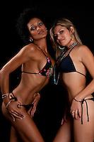 Sensual latin and caucasian girls in bikini posing very sexy.