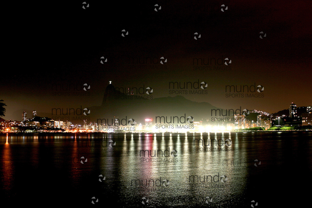 The view across Botafogo Bay to the Corcovado and the Statue of Cristo Redentedor (Christ the Redeemer Statue) overlooking Rio de Janeiro. The photo is taken at night from Urca.