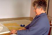 Woman age 53 making wedding dress for daughter.  St Paul  Minnesota USA