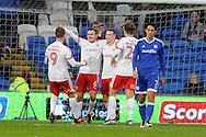 Barnsley's Josh Scowen (6) celebrates after he scores his teams third goal with team mates. EFL Skybet championship match, Cardiff city v Barnsley at the Cardiff city stadium in Cardiff, South Wales on Saturday 17th December 2016.<br /> pic by Carl Robertson, Andrew Orchard sports photography.