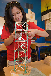 United States, Washington, Seattle, female high school student buiding tower
