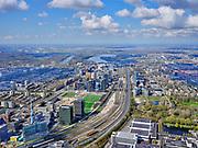 Nederland, Noord-Holland, Amsterdam; 16-04-2021; Overzicht Zuidas gezien vanaf de RAI Amsterdam, en station Rai (onder in beeld).<br /> Overview Zuidas as seen from the RAI Amsterdam, and Rai station (bottom of the picture)<br /> luchtfoto (toeslag op standard tarieven);<br /> aerial photo (additional fee required)<br /> copyright © 2021 foto/photo Siebe Swart